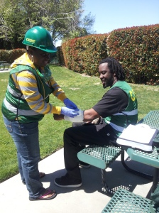 CERT participant Towanda Birmingham-Adams practices light medical care on Corey Nobles.