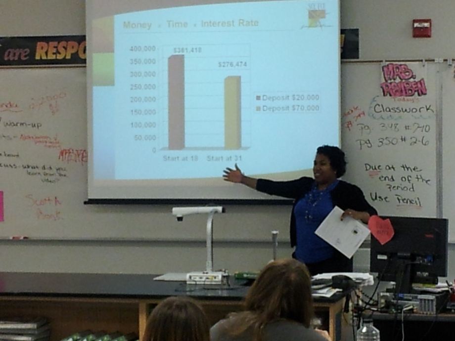 Financial Education Speaker & Author Shay Olivarria talking about compound interest to Seniors at Western High School in Las Vegas, NV for SCE Credit Union.