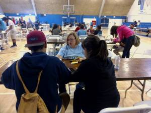Center fro Financial Empowerment Manager Abby Ulm helping students during Mad City Money reality fair at Duarte HS.