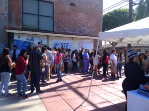 Students getting materials for Mad City Money reality fair in Boyle Heights.